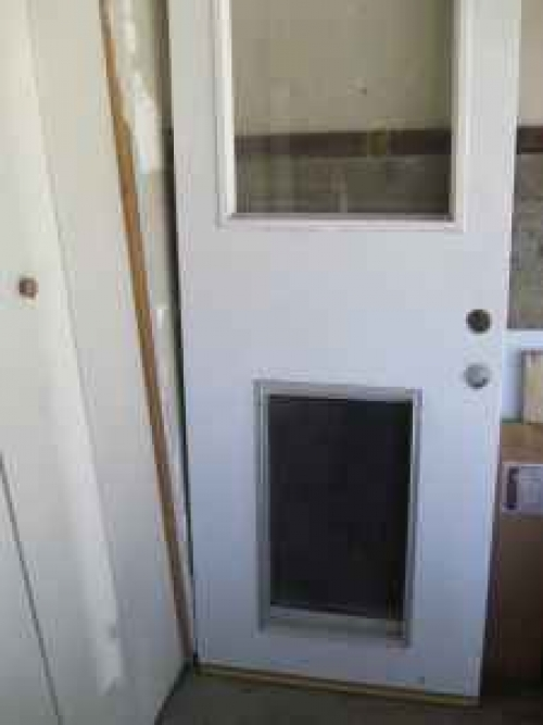 Exterior Door fixed glass + dog door in Los Angeles, CA