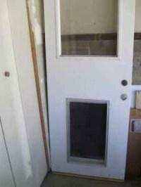Exterior Door fixed glass + dog door in Los Angeles, CA