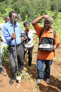 CIAT scientist Fred Kizito (right) uses a Diviner 2000 device to measure soil water over multiple depths in  Babati District, Tanzania where CIAT is carrying out research into sustainable water management (Photo credit: IITA/Jonathan Odhong')