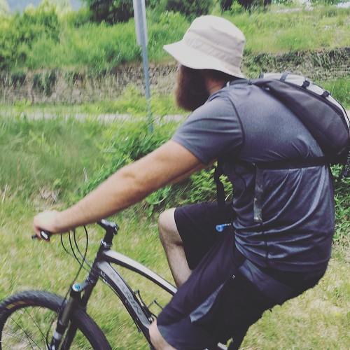 Ryan/Gilligan riding his bike!