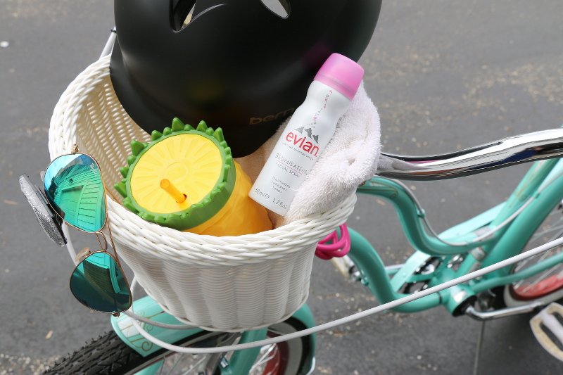 bike-basket-helmet-cycling-essentials-evian-facial-spray-3