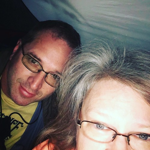 me and the hubby, staying dry in the new tent