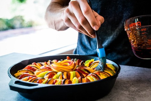 brushing the fruit with glaze