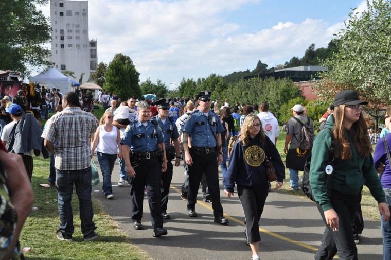 Crowd of people walking forwards
