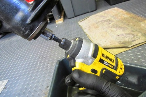 Using Cordless Impact Driver to Remove 10 mm Damper Rod Nut