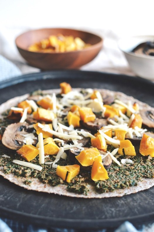 Kale pesto tortilla pizza with mushrooms and delicata squash