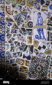 Mosaic design of broken ceramic tiles on wall of house ...