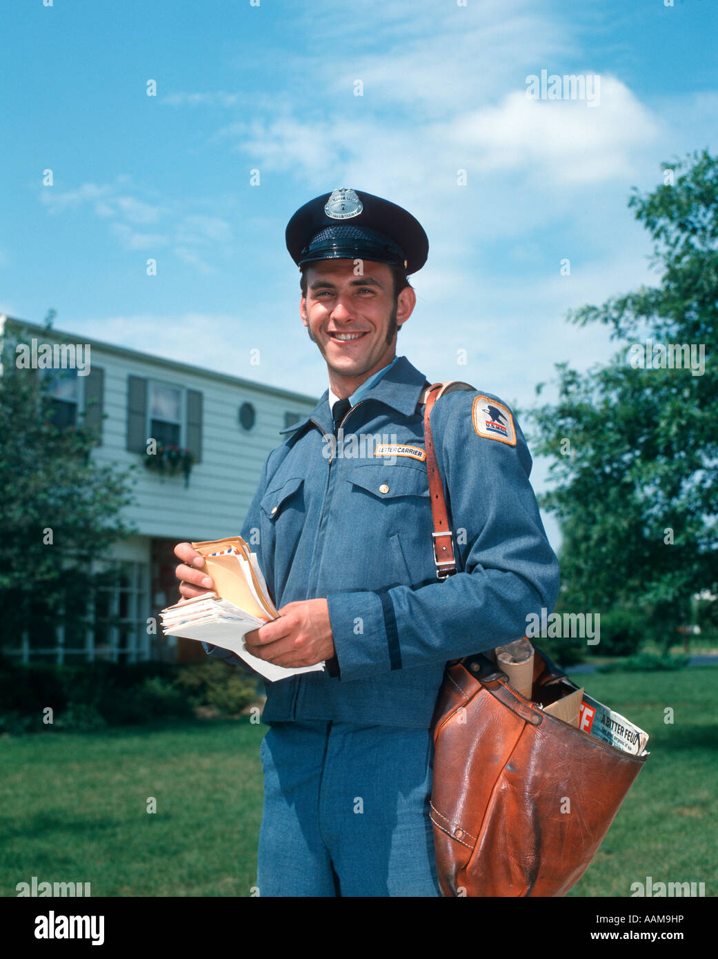 1970s 1980s SMILING MAILMAN MAIL MAN OUTDOORS HOLDING