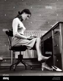 Female Office Worker Sitting Notes Writing Barefoot