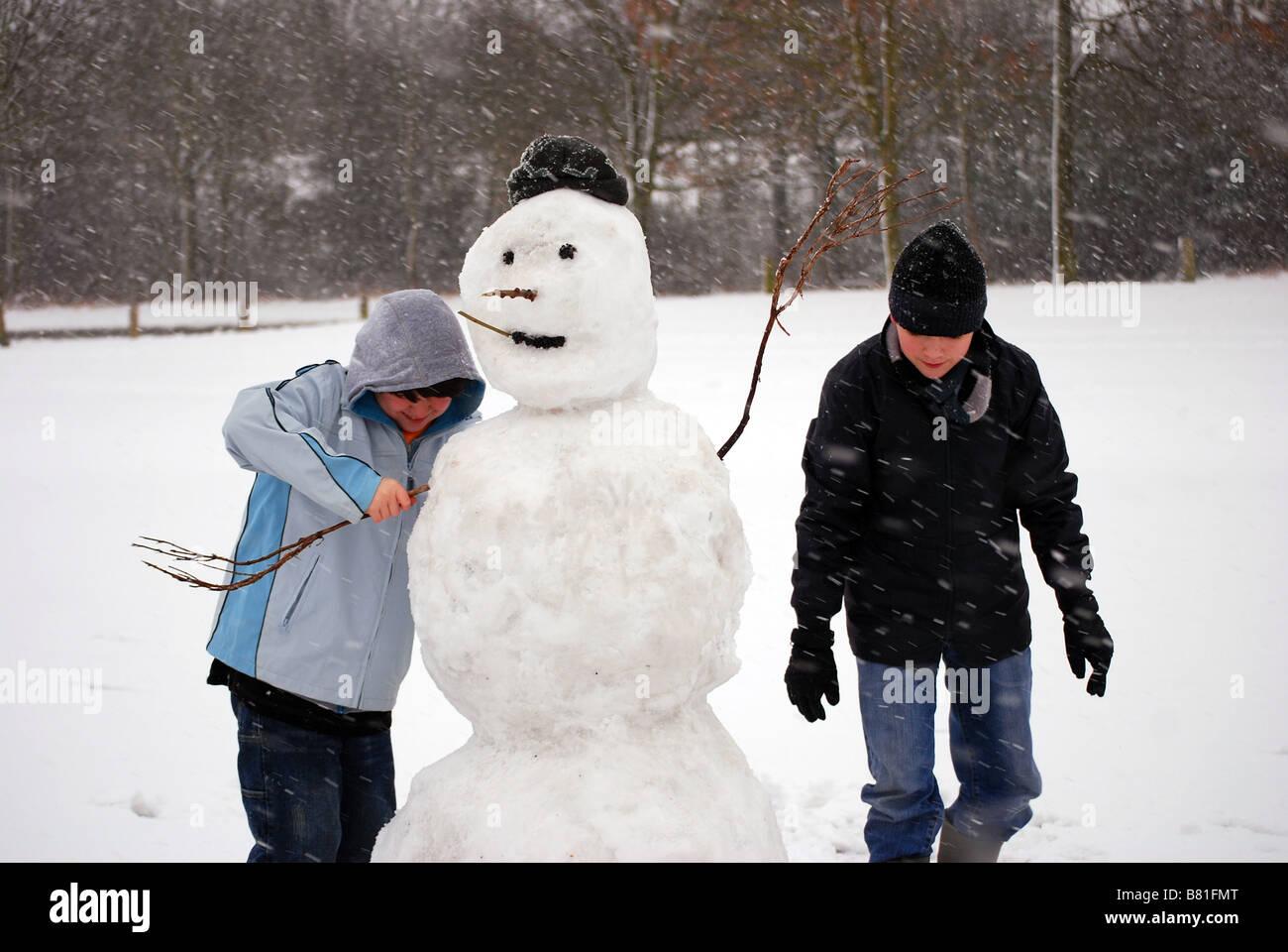 Kids Making A Snowman Stock Photo