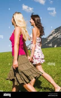 Teenagers Girls Barefoot Walk Meadow Hand In