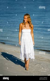 White Blond Young Woman Walking Beach In