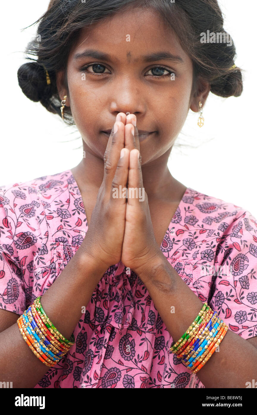 Pretty Little Indian girl with prayer/greeting hands Stock Photo