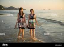 Koh Chang Thailand; Two Girls Walking Barefoot In