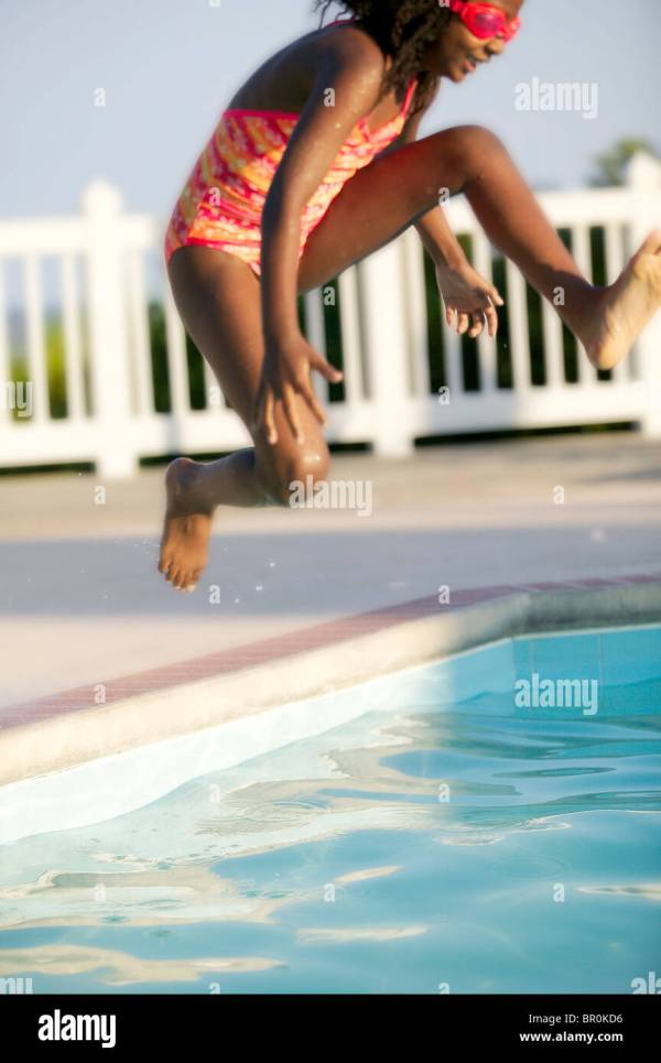 African American Girl Jumping into a Pool