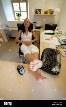 Barefoot Office Woman Feet On Desk