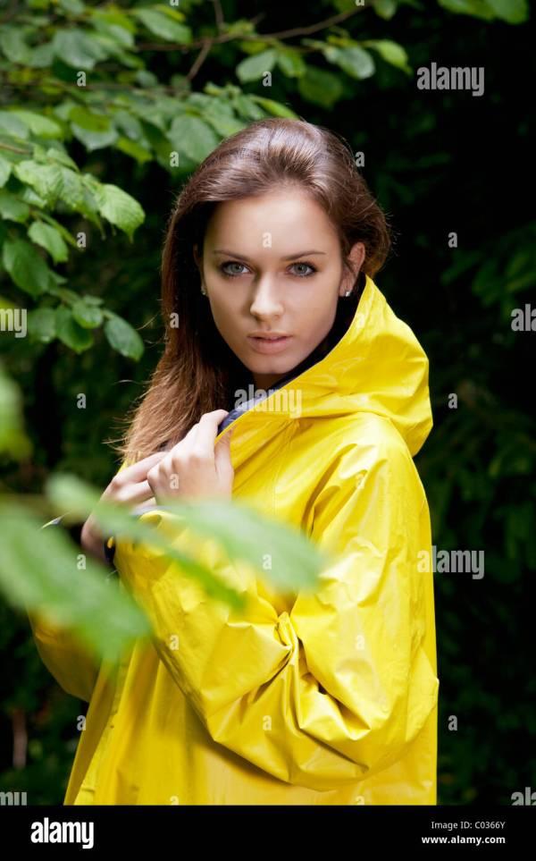 Girl Wearing Yellow Raincoat Stock Royalty Free