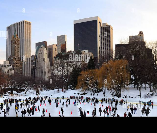 People Skate On Ice With White Christmas In Central Park In Manhattan New York City