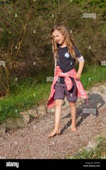Young Girl Walking Barefoot Pebbles