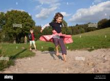 Boy And Girl Jumping Barefoot Park Egestorf Luneburg
