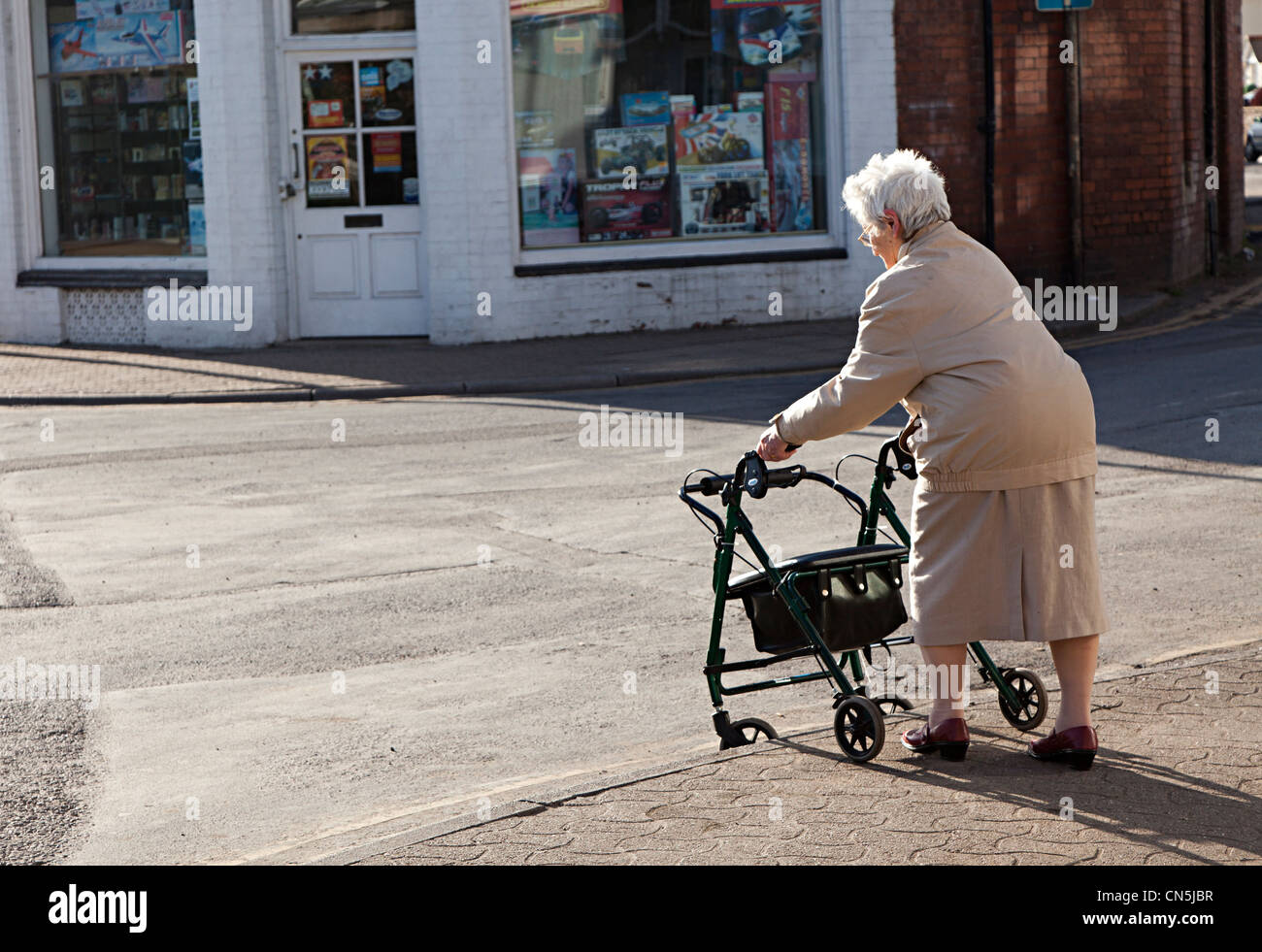 old lady chair cheap covers for weddings to buy woman pushing shopping down kerb in street