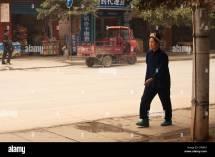Dong Woman Walking Pavement China Stock