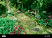 Shade garden with handmade rustic furniture and colorful ...