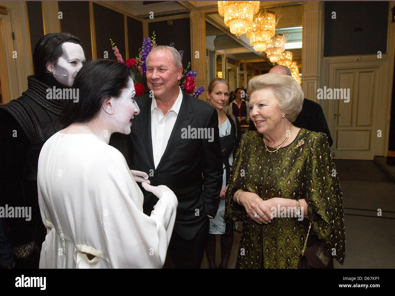 Queen Beatrix of The Netherlands (R) speaks with Serbian-born artist Marina Abramovic (L-R) British singer and composer Stock Photo