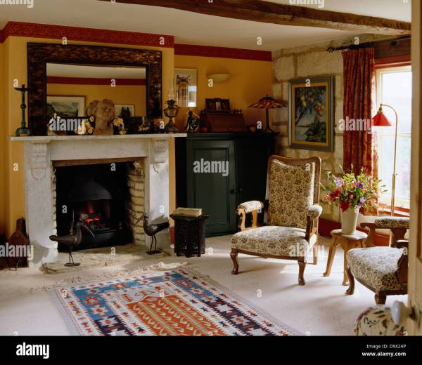 With Large Mirror above Fireplace