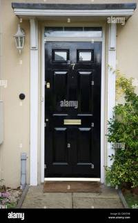 A black front door to a regency style house Stock Photo