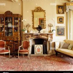 Antique Living Room Chair Styles Rattan Outdoor Chairs Australia Cabinet And French Style In Drawing With Large Gilt Mirror Above Ornate Fireplace