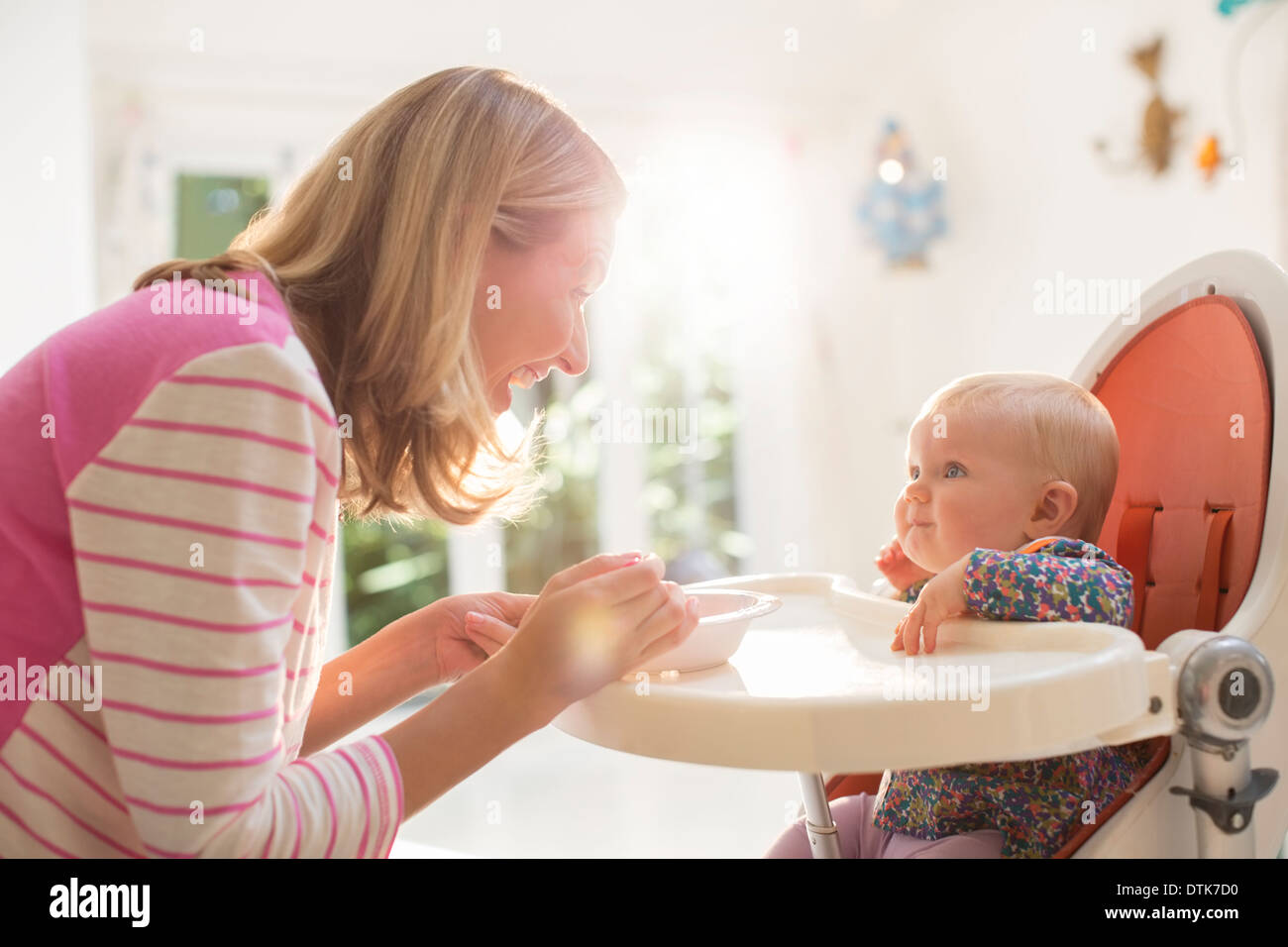 baby girl chair swing price mother feeding in high stock photo 66805788 alamy