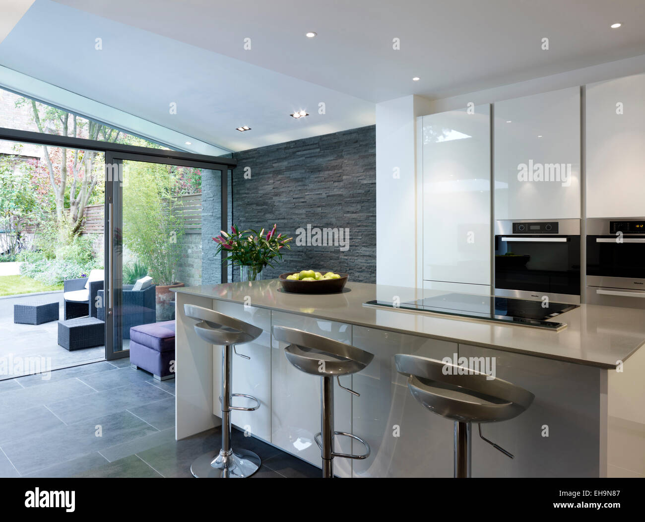 Breakfast bar with stools in open plan kitchen and living area in Stock Photo 79504887  Alamy