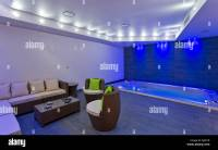 Indoor pool room and spa with feature lighting. Mews House