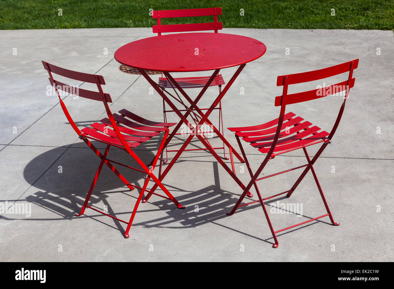 Red Patio Chairs Red Folding Patio Chairs And Table On A Concrete Surface Stock