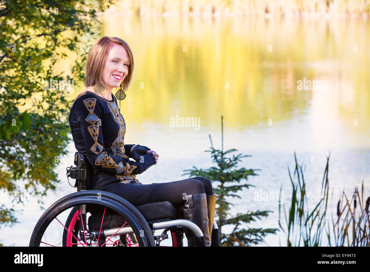 quadriplegic wheelchair bent wood chair parts young paraplegic woman in her by water a