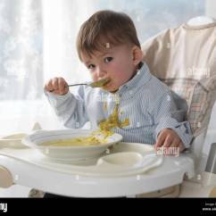 Eating Chair For Toddlers Single Fold Out Bed Toddler Boy Sitting In A High Soup With