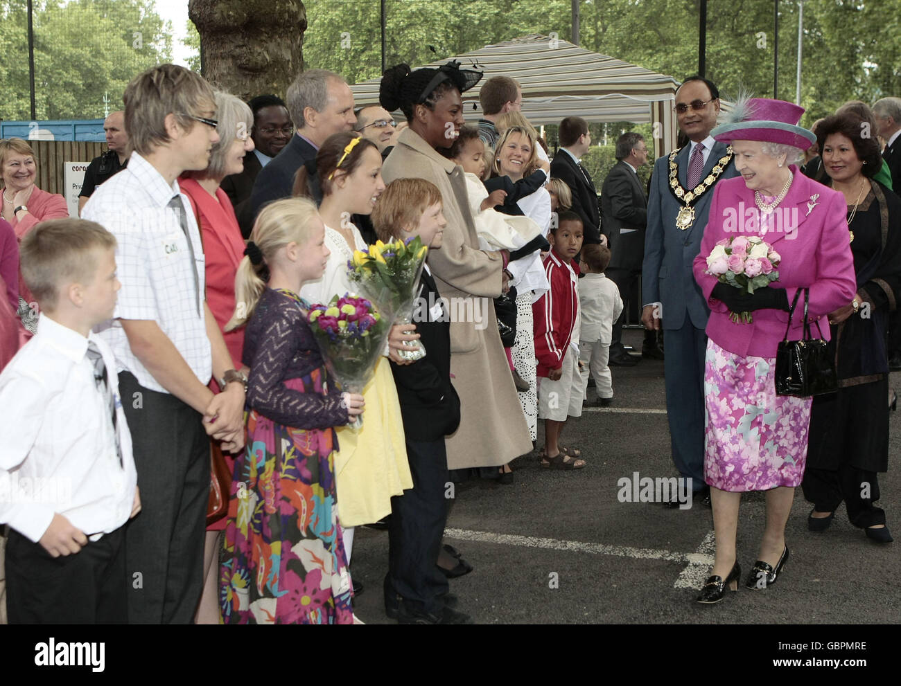 Queen visits Coram children's charity Stock Photo