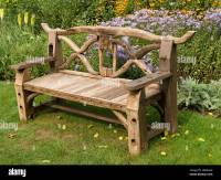 Ornate, rustic, wooden garden bench seat made from ...