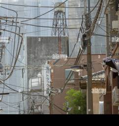 telephone and electrical wires form a messy tangle above a street in tokyo japan friday november 4th 2016 [ 1300 x 956 Pixel ]