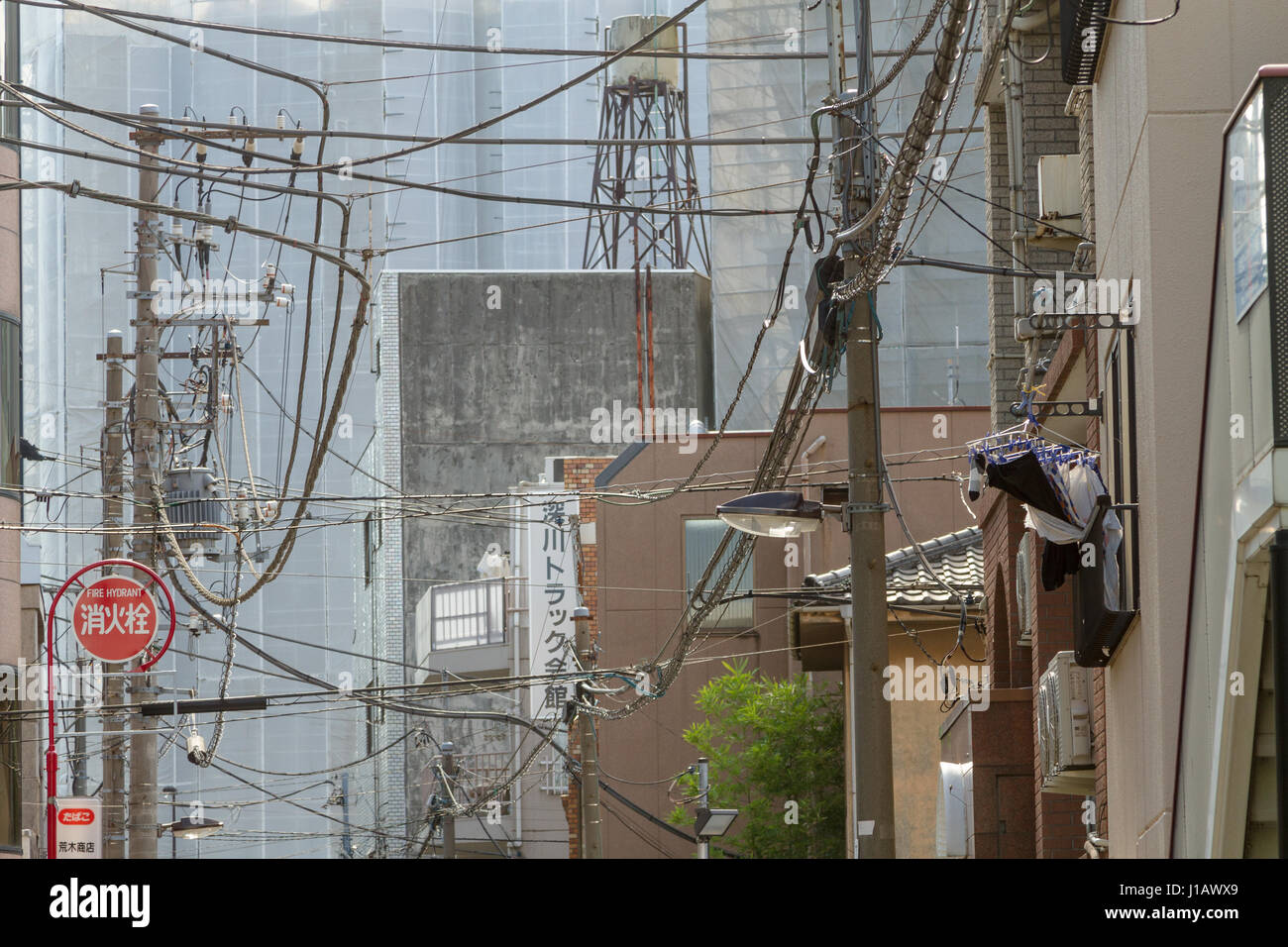 hight resolution of telephone and electrical wires form a messy tangle above a street in tokyo japan friday november 4th 2016