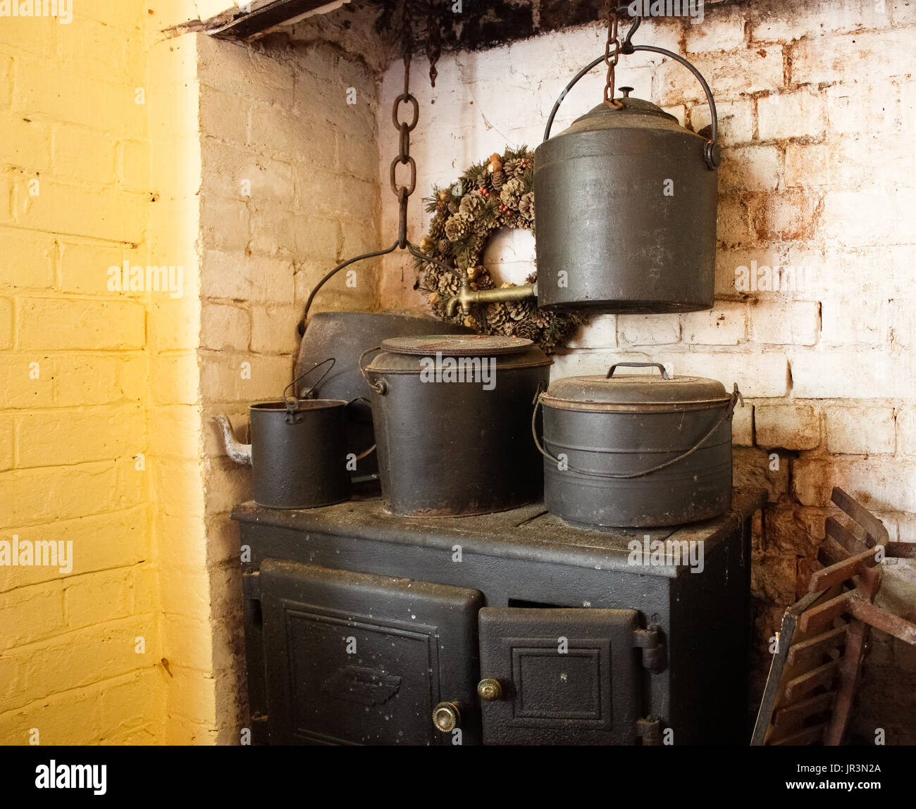 cast iron kitchen stove plastic containers pots stock photos and images