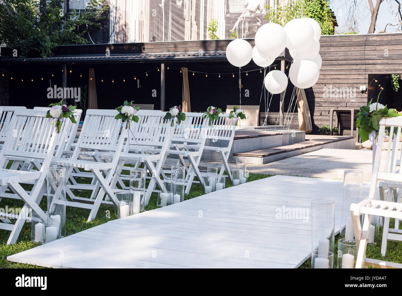 chair covers malta modern tan leather dining beach wedding ceremony set up stock photos & images - alamy