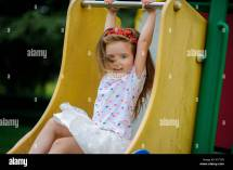 Girl Sitting Jungle Gym Stock &