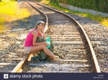 Girl Walking Rail Track Stock &