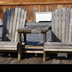 Distressed Adirondack Chairs High Chair Alternatives Weathered And Table On A Dock Stock Photo