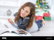 Barefoot Young Girl Reading Magazine Stock