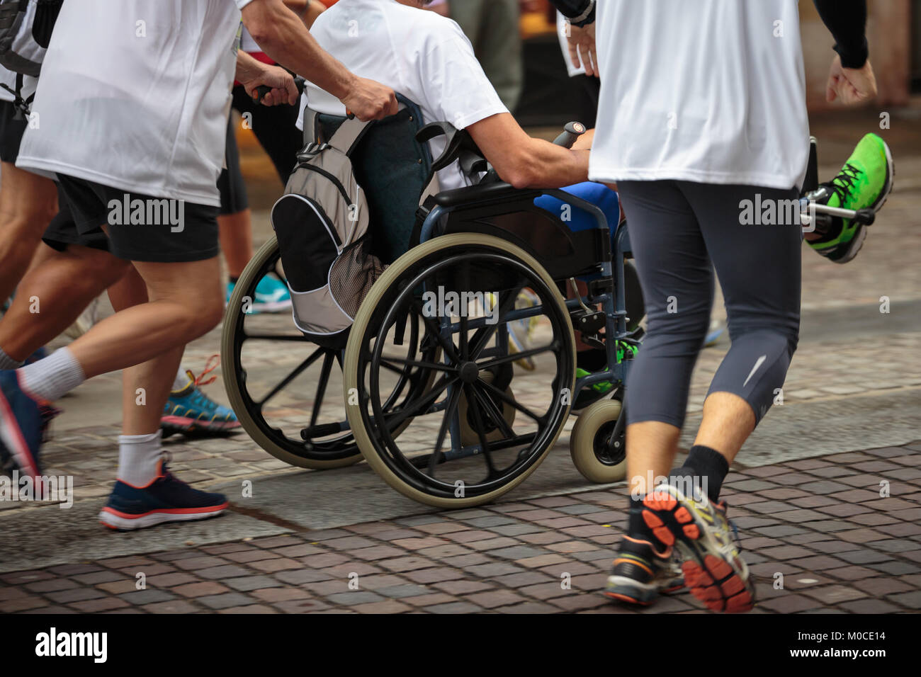 wheelchair marathon colored dining chairs male runner stock photos and