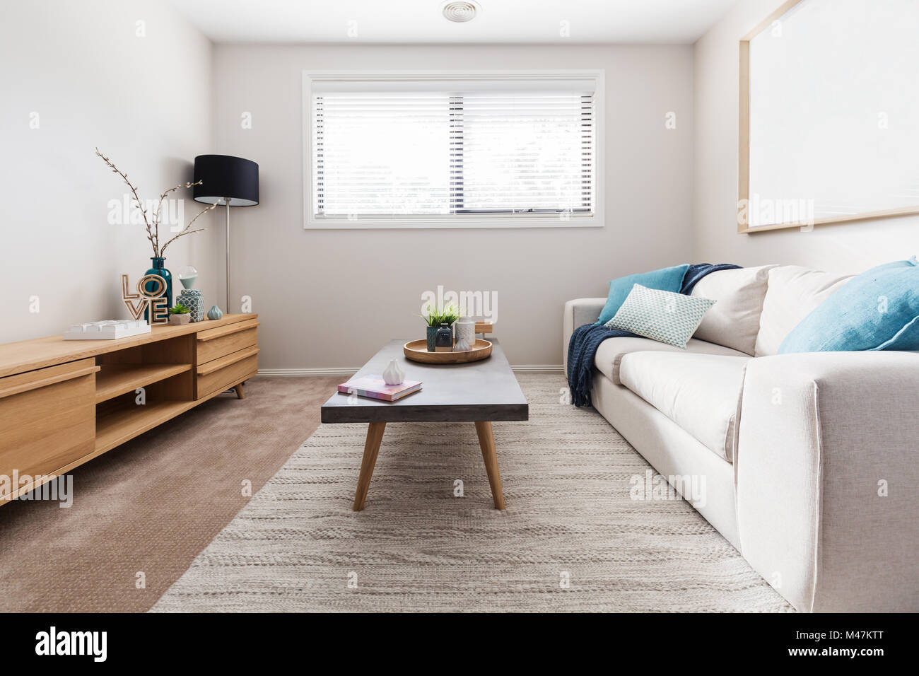teal accents living room pictures of rooms with white leather sofas scandi style interior accent cushions stock