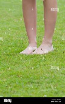Closeup Legs Woman Standing Barefoot Stock